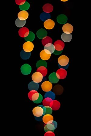 cone shaped: Cone shaped lights with different colors defocused and isolated on black background. Stock Photo