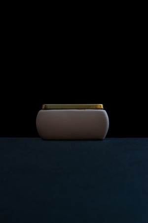jewelry box: White jewelry box with golden edging on a black background. Stock Photo