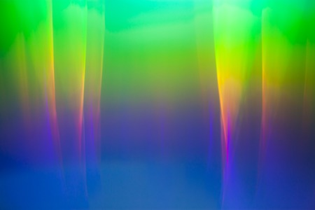 diffraction: Light dispersion from a compact disk surface. Rainbow effect.