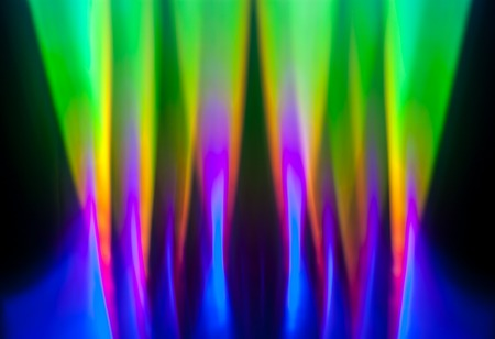 Light dispersion from a compact disk surface. Rainbow effect.