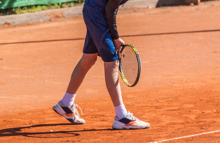 serve: Young tennis player concentrating and getting ready to return a serve from the opposite player.