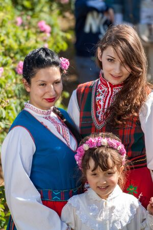bulgaria girl: ROZOVO, BULGARIA - JUNE 06, 2015 - Rose picking ritual in Rozovo village. People dressed up in a traditional folklore costumes sing and dance for health and succesful harvest of the Bulgarian Roses.