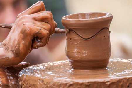 pottery: Close-up of pottery being decorated