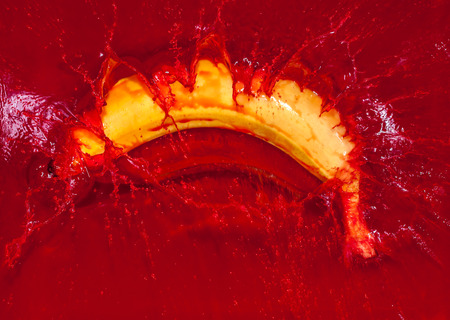 red water: Yellow banana falling into red water and creating a splash