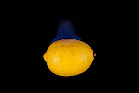 ot: Lemon ot fire with blue flames isolated on black background Stock Photo