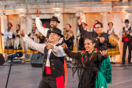 folklore: PLOVDIV, BULGARIA - AUGUST 06, 2015 - 21-st international folklore festival in Plovdiv, Bulgaria. The folklore group from Spain dressed in traditional clothing is preforming Spanish national dances.