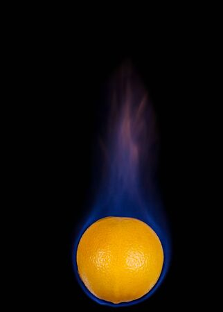 blue flames: Orange on fire with blue flames isolated on black background