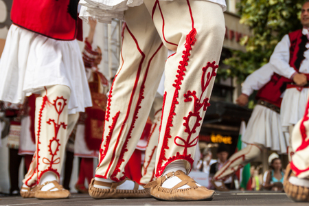 show folk: PLOVDIV, BULGARIA - AUGUST 06, 2015 - 21-st international folklore festival in Plovdiv, Bulgaria. The folklore group from Bulgaria dressed in traditional clothing is preforming Bulgarian national dances.