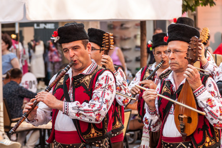 folklore: PLOVDIV, BULGARIA - AUGUST 06, 2015 - 21-st international folklore festival in Plovdiv, Bulgaria. The folklore group from Bulgaria dressed in traditional clothing is preforming Bulgarian national dances.