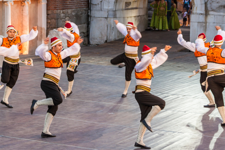 show folk: PLOVDIV, BULGARIA - AUGUST 06, 2015 - 21-st international folklore festival in Plovdiv, Bulgaria. The folklore group from Turkey dressed in traditional clothing is preforming Turkish national dances.