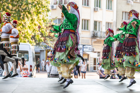 folklore: PLOVDIV, BULGARIA - AUGUST 06, 2015 - 21-st international folklore festival in Plovdiv, Bulgaria. The folklore group from Turkey dressed in traditional clothing is preforming Turkish national dances.