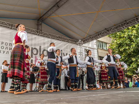 folklore: PLOVDIV, BULGARIA - AUGUST 06, 2015 - 21-st international folklore festival in Plovdiv, Bulgaria. The folklore group from Serbia dressed in traditional clothing is preforming Serbian national dances.