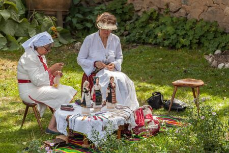 bulgaria girl: KOPRIVSHTITSA, BULGARIA - AUGUST 08, 2015 - National Festival of the Bulgarian Folklore in Koprivshtitsa, Bulgaria. Folklore groups from different cities dressed in traditional clothing are preforming Bulgarian national dances.