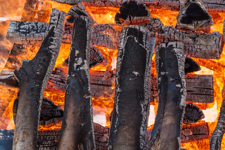 arranged: Wood logs arranged as a stack set on fire.