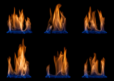 flame background: Blue and yellow colored flames isolated on black background