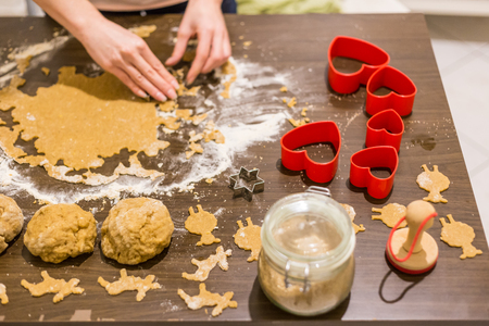 deer in heart: Cutting cookies from a dough with different shapes