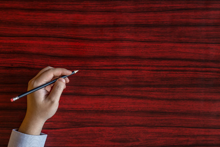 empty handed: Left handed person writing with a pencil