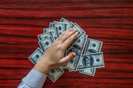 grabbing: Hands grabbing money from a desk Stock Photo