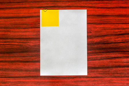 attached: Heart shaped paper clip attached to a sheet of paper with a yellow sticky note