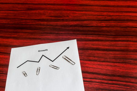 spreaded: Curve graph printed on a sheet of paper and spreaded paper clips