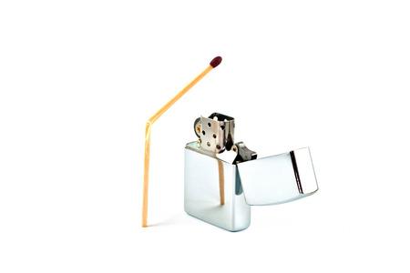 cigarette lighter: Shiny cigarette lighter and broken matchstick