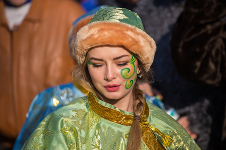 bulgaria girl: PERNIK, BULGARIA - JANUARY 30, 2016 - Masquerade festival Surva in Pernik, Bulgaria. People with mask called Kukeri dance and preform to scare the evel spirits.