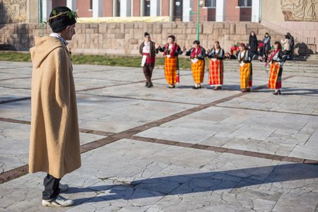 customs and celebrations: PERUSHTITSA, BULGARIA - FEBRUARY 14, 2015 - Recreating the ritual called Zariazvane in Perushtitsa, Bulgaria. People dressed in traditional clothing dance and cut the vineyards for fruitful harvest.