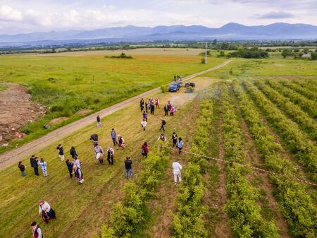 succesful: RAZHENA, BULGARIA - MAY 22, 2016 - Aerial view of rose picking ritual in Razhena village. People dressed up in a traditional folklore costumes sing and dance for health and succesful harvest of the Bulgarian Roses.