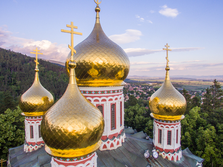 christ: Aerial closeup view of the goledn domes of church Birth of Christ near Shipka, Bulgaria. Stock Photo