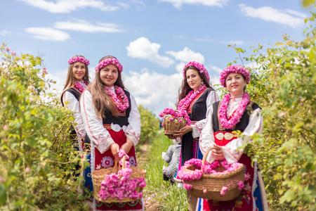 bulgaria girl: Three Bulgarian girls dressed in traditional dress picking roses during the Annual Rose Festival in Kazanlak, Bulgaria Stock Photo