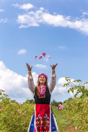 bulgaria girl: Bulgarian girl dressed in traditional clothing throwing rose in the air during the Annual Rose Festival in Kazanlak, Bulgaria