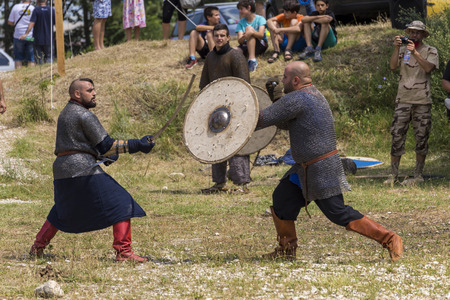 swoop: ASENVOGRAD, BULGARIA - JUNE 25, 2016 - Medieval fair in Asenovgrad recreating the life of Bulgarians during the Middle ages. Demonstration of a ancient duel.