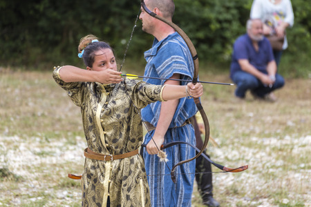 recurve: ASENVOGRAD, BULGARIA - JUNE 25, 2016 - Medieval fair in Asenovgrad recreating the life of Bulgarians during the Middle ages. Bow and arrow shooting contest. Editorial