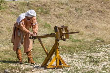 siege: ASENVOGRAD, BULGARIA - JUNE 25, 2016 - Medieval fair in Asenovgrad recreating the life of Bulgarians during the Middle ages. Demonstrating and firing an arrow from a ballista.