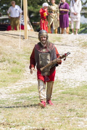arbalest: ASENVOGRAD, BULGARIA - JUNE 25, 2016 - Medieval fair in Asenovgrad recreating the life of Bulgarians during the Middle ages. Man with mail and crossbow.