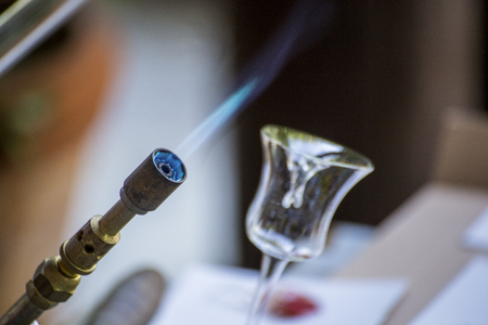 propane: Small propane torch with blue flame. Made for melting and shaping glass Stock Photo
