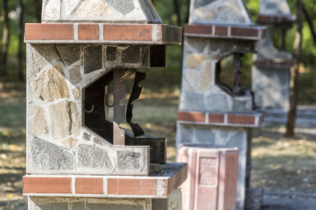Three barbeque fireplaces located in a park for public usage. Stock Photo