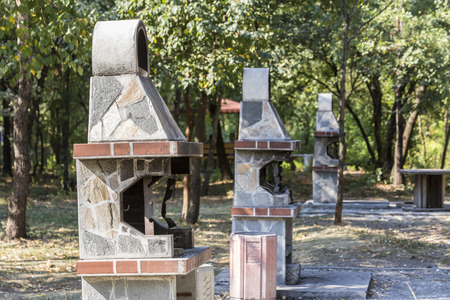 fireplaces: Three barbeque fireplaces located in a park for public usage. Stock Photo