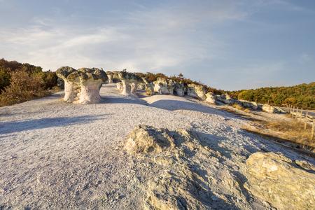 Prodigy: Mushroom rock phenomenton located near Beli Plast village, Bulgaria during sunset with dramatic sky.
