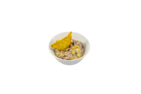 tuna mayo: Small white bowl with tuna salad and tortilla chips isolated on white background. Stock Photo