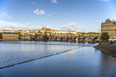 Amazing blue sky over the famous Charles bridge over the Vltava river in Prague Stock Photo