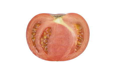 Closeup shot of a cross section of a pink tomato isolated on white background
