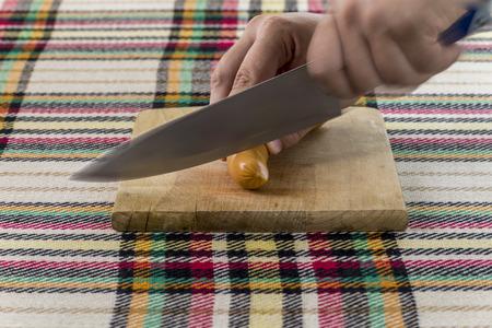 Cutting traditional Bulgarian frankfurter sausage called nadenitsa krenvirsh.