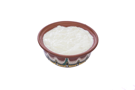 Ttraditional bulgarian yogurt in a traditional bowl isolated on white background Stock Photo