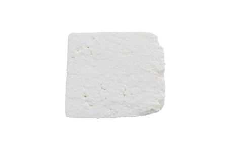 Slice of traditional bulgarian salty white cheese isolated on a white background