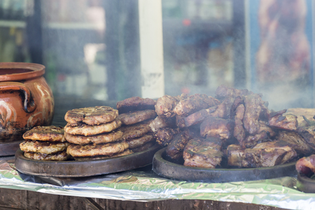 Many different barbecue meats and sausages on a grill Stock Photo
