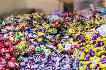 Pile of multi-colored packaged candy