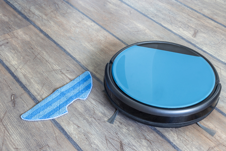 Water tank of a robot vacuum claner. Mop feature with attachment. Stock Photo