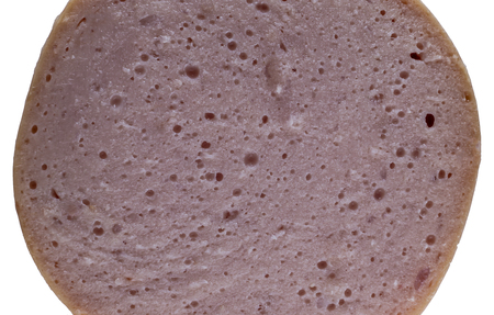 Extreme macro shot of hot dog wiener cross section showing the structure of the surface.