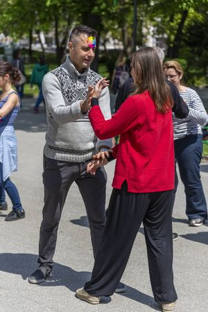 PLOVDIV, BULGARIA - APRIL 21, 2019 - Tai chi chuan training demonstration in a park in Plovdiv city in Bulgaria
